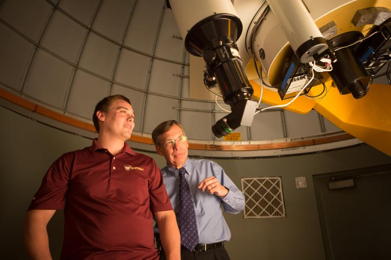 Student and professor in observatory